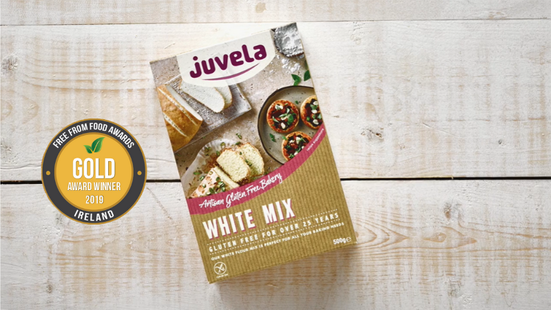 Juvela White Gluten Free Mix box against a rustic wooden table