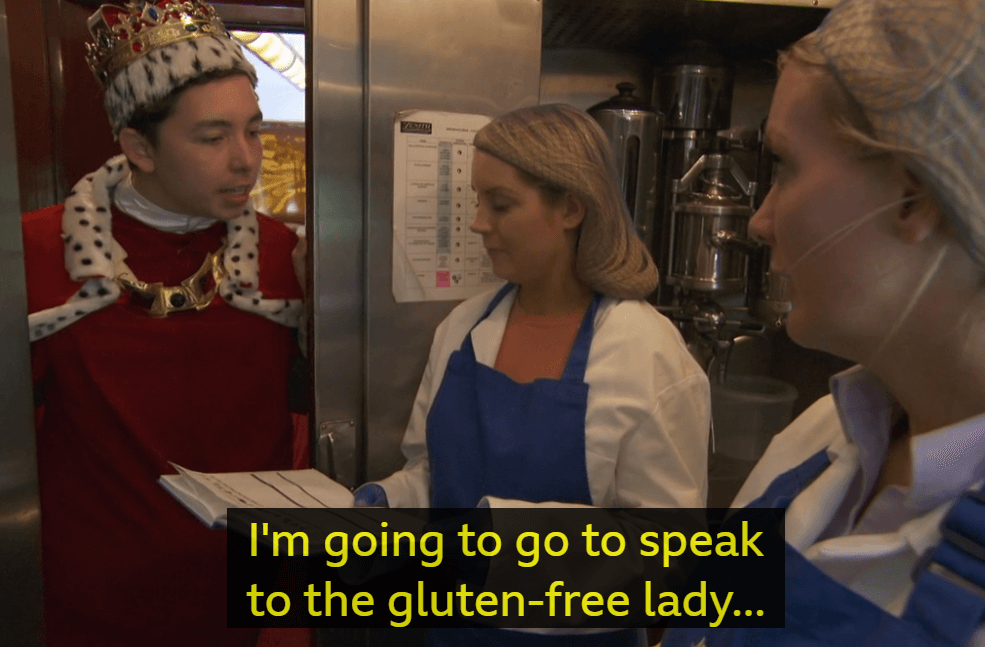 "Screenshot from an episode of The Apprentice, of a man in a costume saying ""I'm going to go talk to the gluten free lady"""