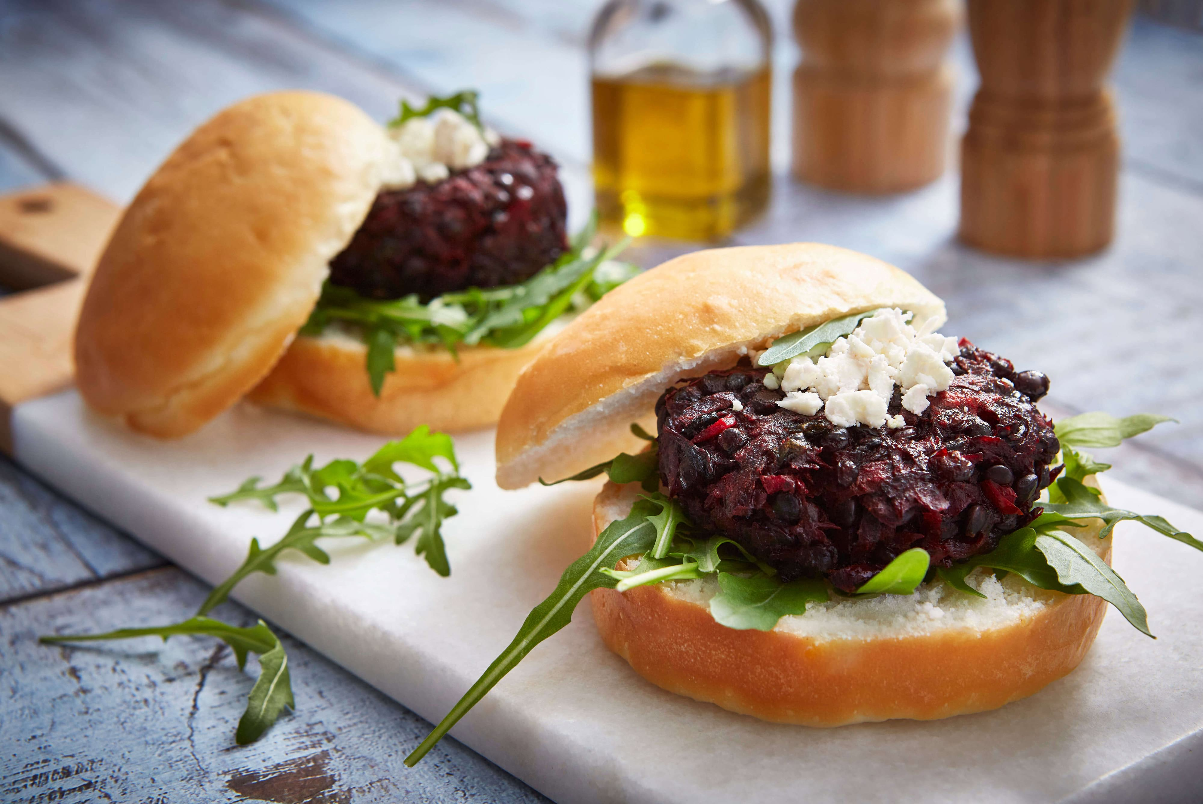 Beetroot burgers on a blue background