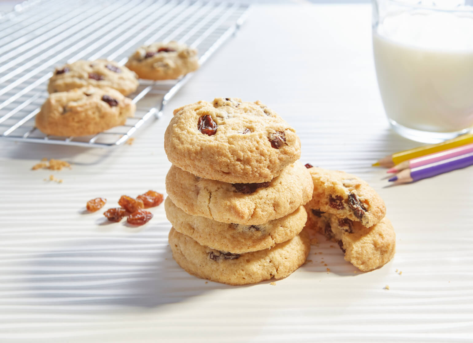 A stack of sultana cookies against a white background